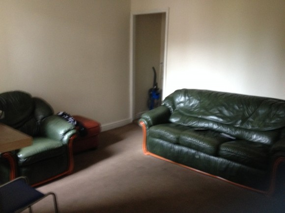 This is spacious communal area has a sofa, chairs, table and a TV with Sky TV.